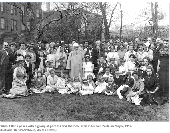 Abdu'l-Baha poses with a group of parents