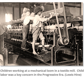 Children working at a mechanical loom in a textile mill