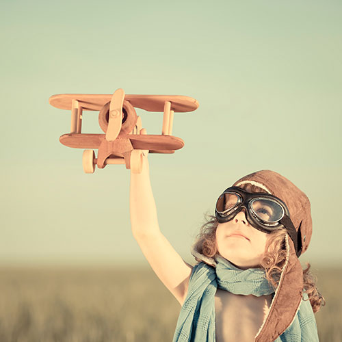 Little girl with airplane