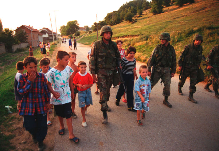 US Marines escort Albanian children during Kosovo war