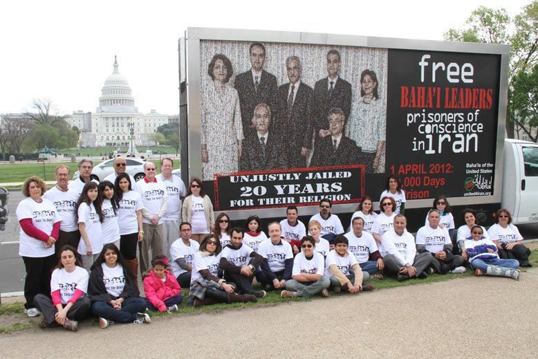 People gather for a photograph outside the U.S. Capitol with a mobile billboard marking the seven Baha'i leaders' combined 10,000 days of incarceration. (Source: bahai.us)