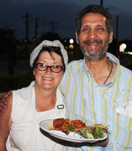 Chef Joan Cheever serving food to a homeless man