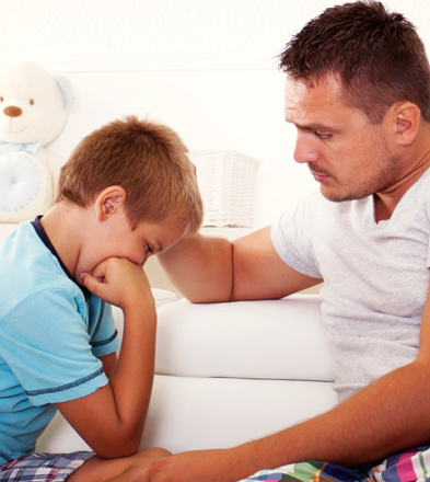 Boy-crying-with-father