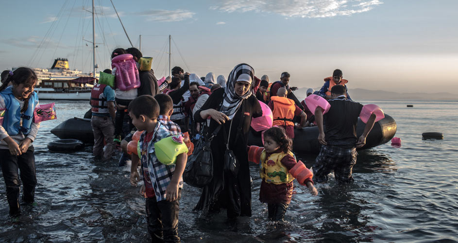 Syrian migrants landing on the shores of Greece