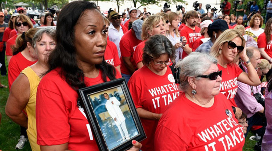 Pam Bosley of Chicago, left, holds a photo of her son Terrell Bosley, who was killed in 2006 when he was 18, as she attends a rally against gun violence in September on Capitol Hill. Photograph: Susan Walsh/AP
