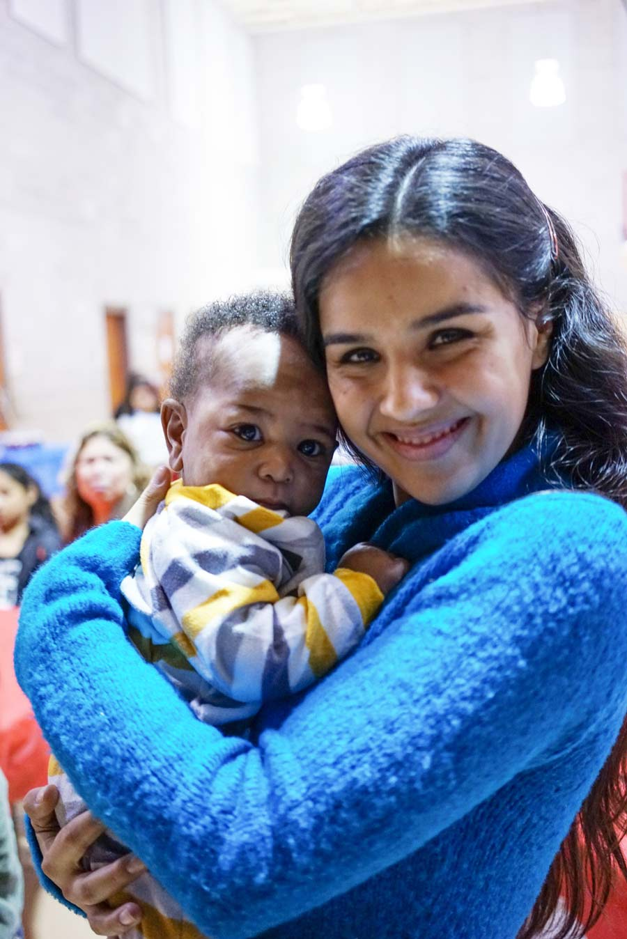 Tahirih Justice staff member with the child of a client