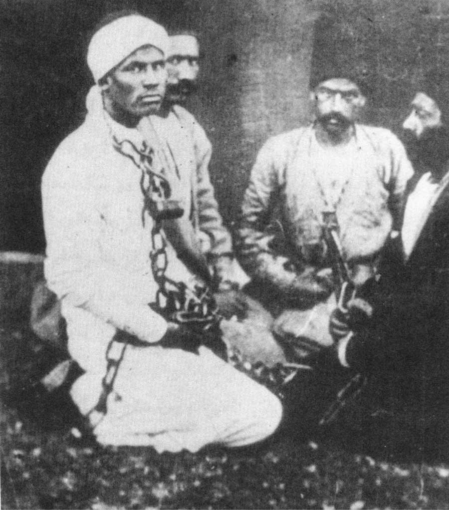 Photograph of Badi in chains