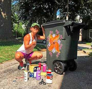 Esther Cohen-Eskin painting her trash can.