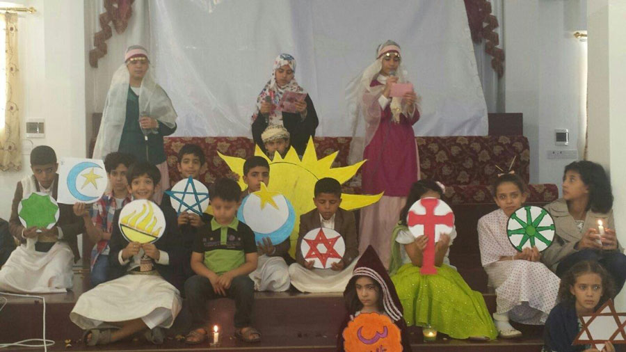 Children celebrating the commonalities of all faiths at a community event.