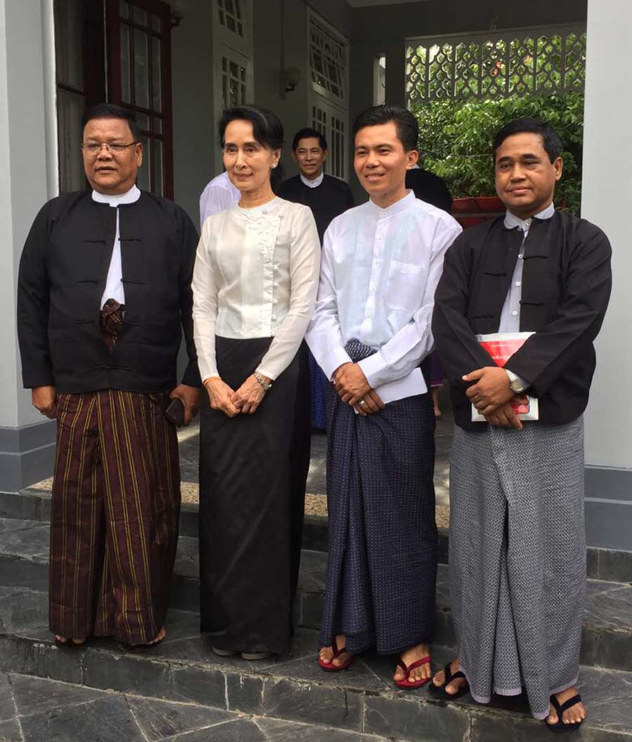 Aung San Suu Kyi (center left) with representatives of the Baha'i community of Myanmar (from left to right: U Shwe Thee, U Myint Zaw Oo, U Tin Win)