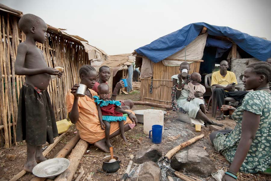 People have breakfast in displaced persons camp, Juba, South Sudan.