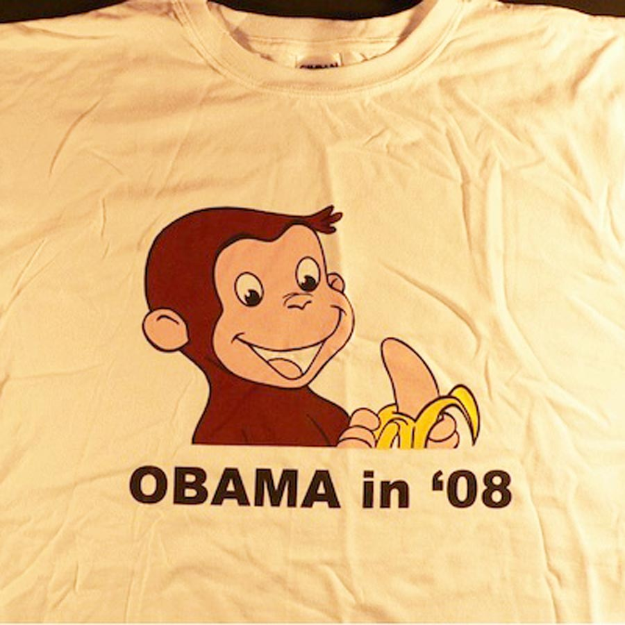 Racist depiction of Obama as Curious George on a t-shirt.