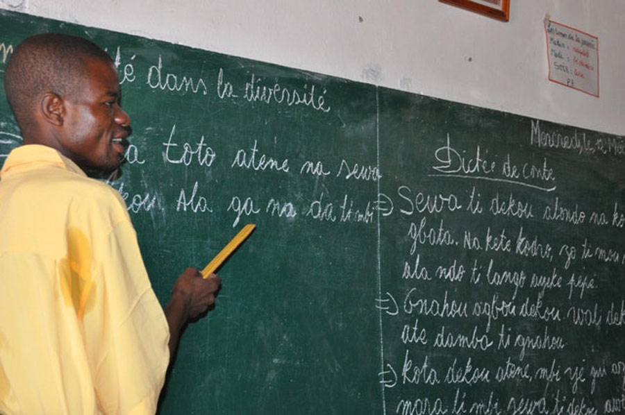A teacher conducts a lesson at a community school in Bangui.
