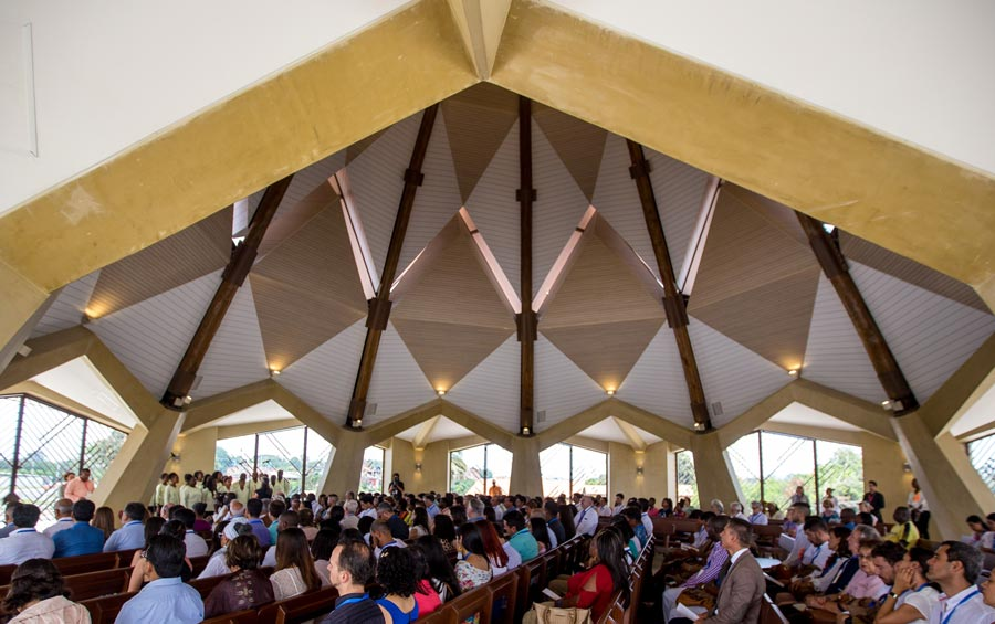 Participants sit inside the House of Worship for its first devotional program.