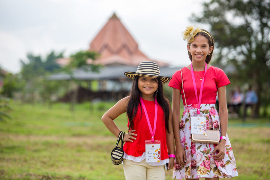 Two girls from the Caribbean coast of Colombia smile during the dedication ceremony.