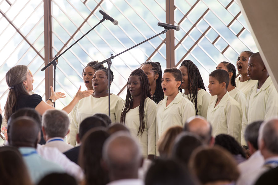 A choir sings a passage from the Baha'i writings inside the central edifice of the recently opened Baha'i House of Worship in Agua Azul, Colombia. (courtesy of Bahai.org)