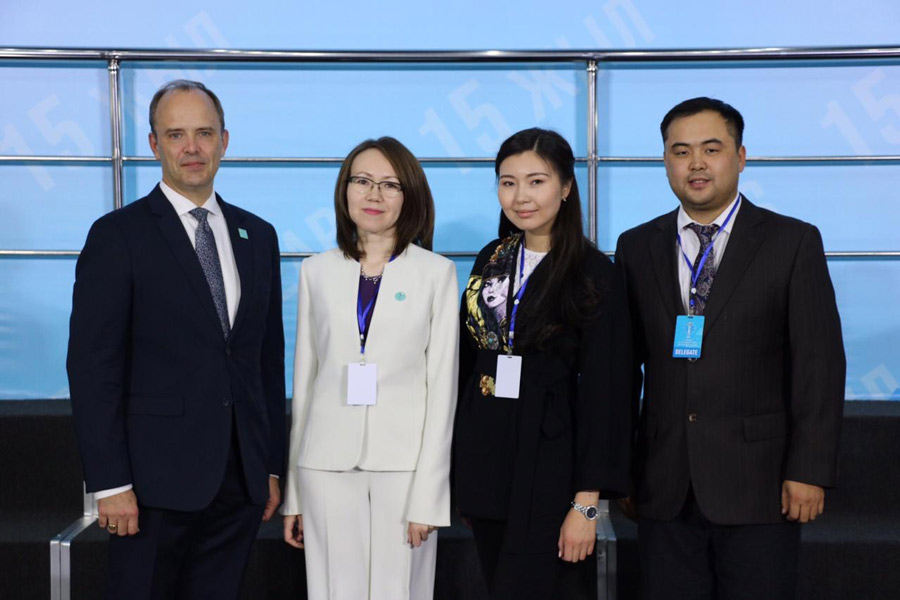 (from left) Joshua Lincoln, Secretary-General of the Baha'i International Community; representative Lyazzat Yangaliyeva from the Baha'i community of Kazakhstan; Guldara Assylbekova of the International Center of Cultures and Religions; and Serik Tokbolat, also representing the Baha'i community of Kazakhstan.