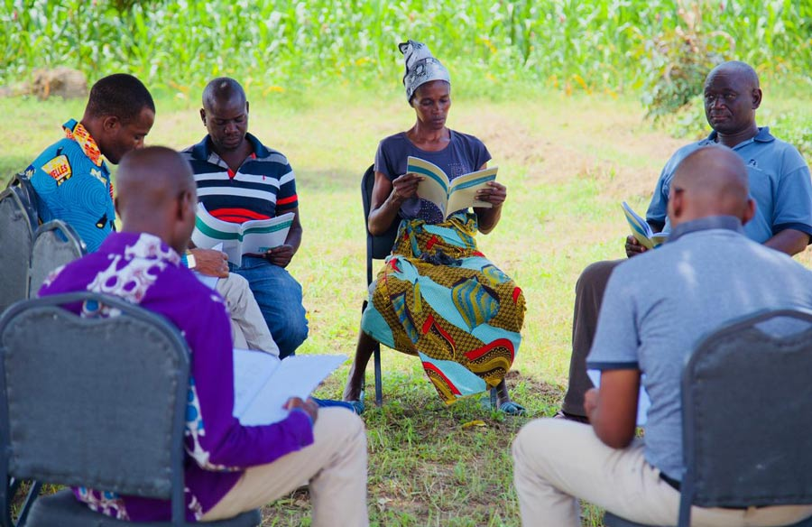 A group of participants in one of Inshindo Foundation's educational programs studies at the Ngungu Center for Community Agriculture.
