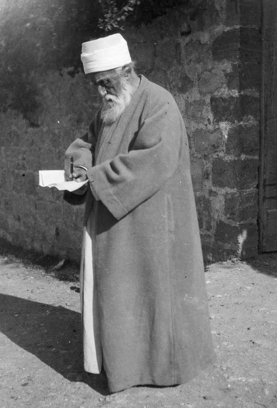 'Abdu'l-Baha pens a letter while He was in the Holy Land in 1920.