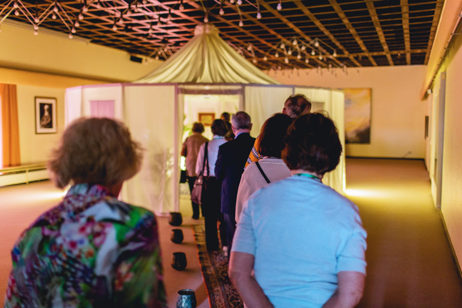 People line up to view a special exhibit of historic items related to the lives of the Bab and Baha'u'llah, displayed during the Ridvan period in Langenhain, Germany.