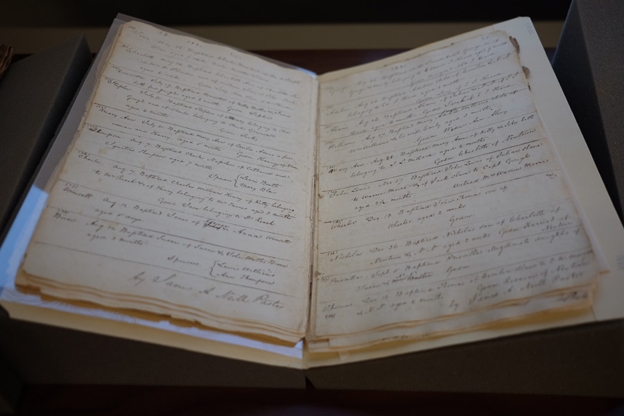 One of the archives pieces on display at the event: a sacramental register kept by the Jesuits at St. Francis Xavier Church in the state of Maryland. It records baptisms of free and enslaved people in the 1820s and 1830s.