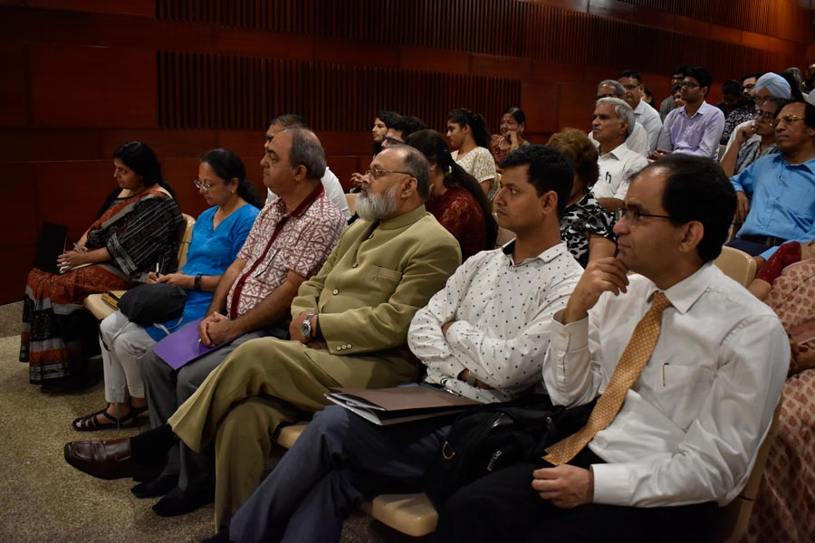 Participants in the seminar listen to the discussion among panelists.