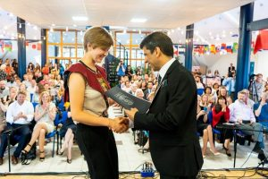 dr vivek williams presenting a student with award