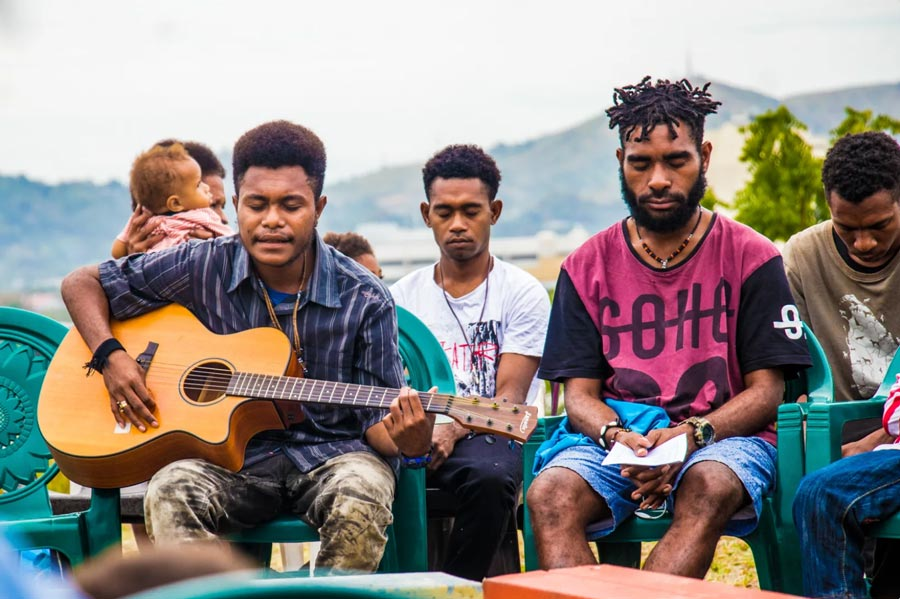 Prayers and music inspire attendees of a devotional gathering held at the site of the future Bahá'í House of Worship in Port Moresby, Papua New Guinea. In honor of the historic bicentenary, young people at the gathering also presented about the life of the Báb.