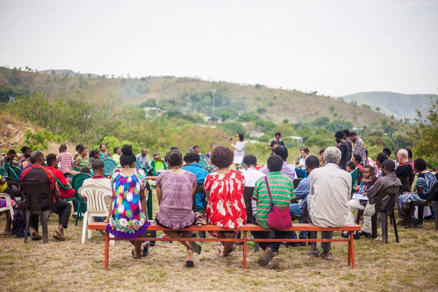 Community members in Port Moresby, Papua New Guinea, gather for prayers at the Temple's site in August, before construction began.