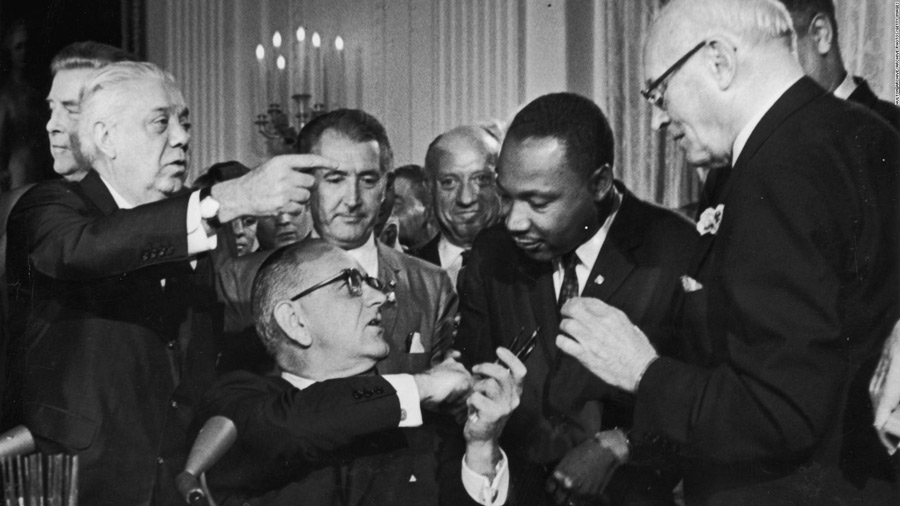 President Lyndon Johnson congratulates the Rev. Martin Luther King Jr. at the signing of the 1964 Civil Rights Act.