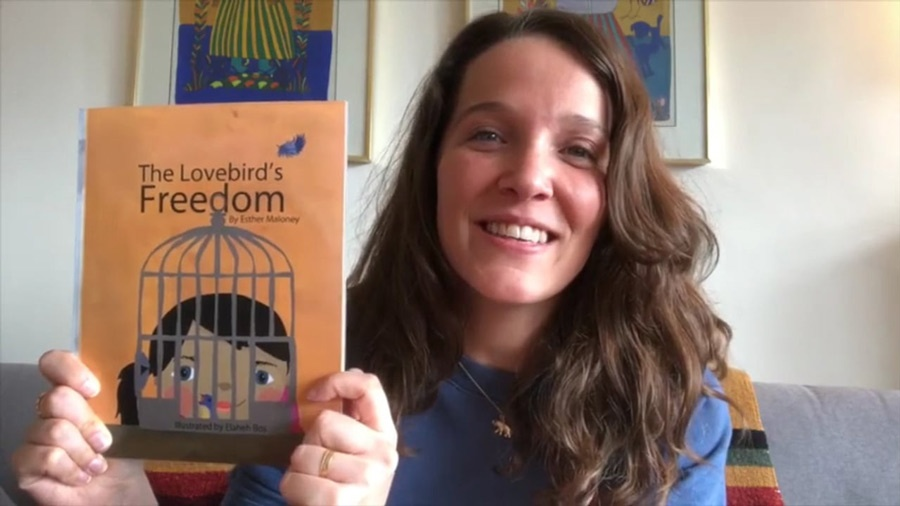 Esther Maloney holding up her book 'The Loverbird's Freedom'
