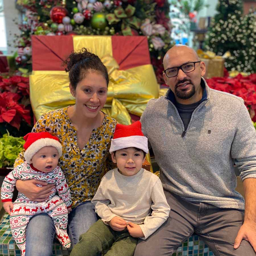 Elaina Barroso and Aaron Ginoza with their children.