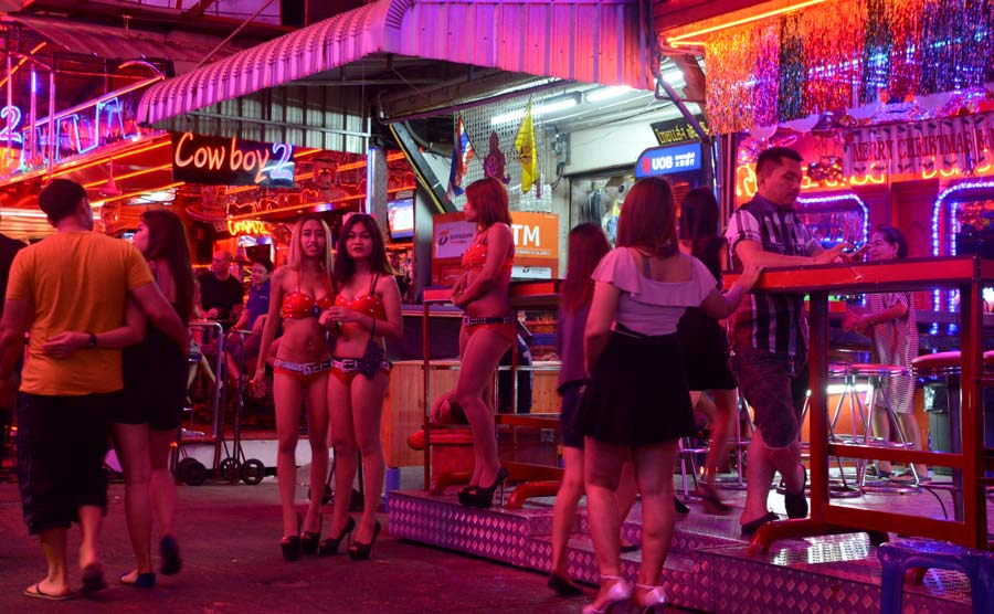 Bangkok, Thailand - January 2, 2016: Thai women outside a Go-go Bar in Soi Cowboy, a short walking street of bars and strip clubs in the Asok-Sukhumvit district.