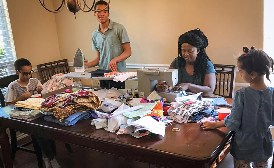 A family in Rockwall, Texas, prepared protective masks for non-medical use and left them for neighbors.