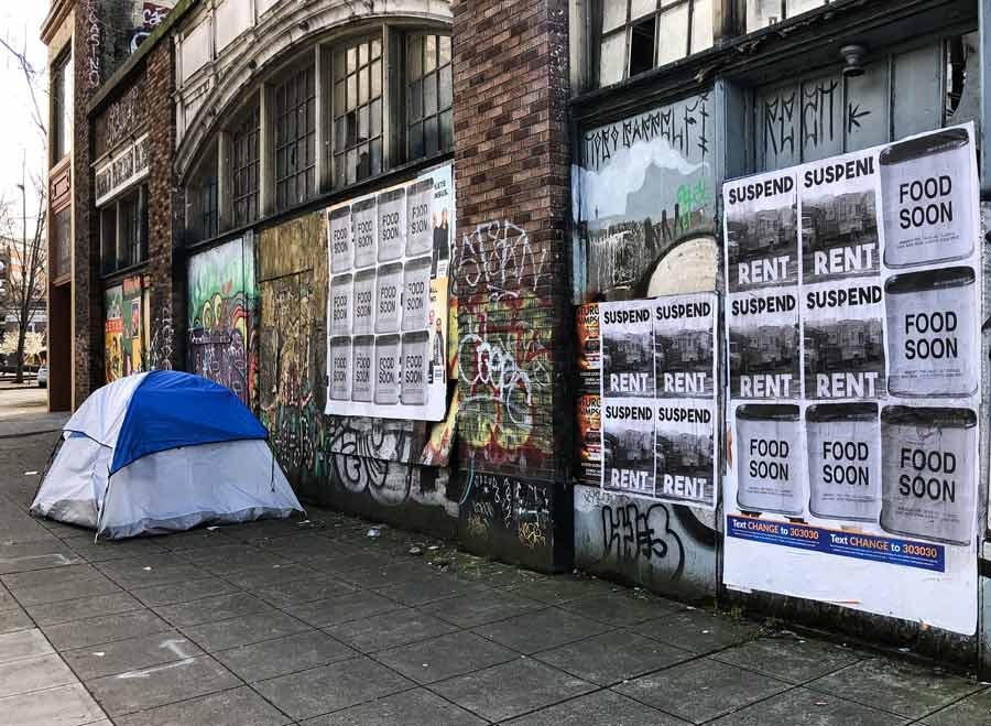 Boarded up businesses with rent strike posters in Seattle, WA (March 31, 2020).