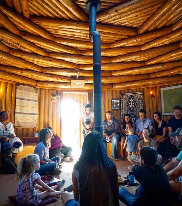 A prayer gathering inside the Prayer Hogan at the Native American Baha'i Institute in the Navajo Nation.