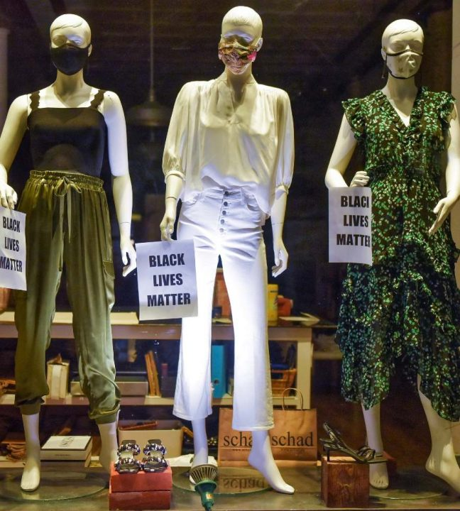 Mannequin display in the window of a women's clothing boutique in Canada.