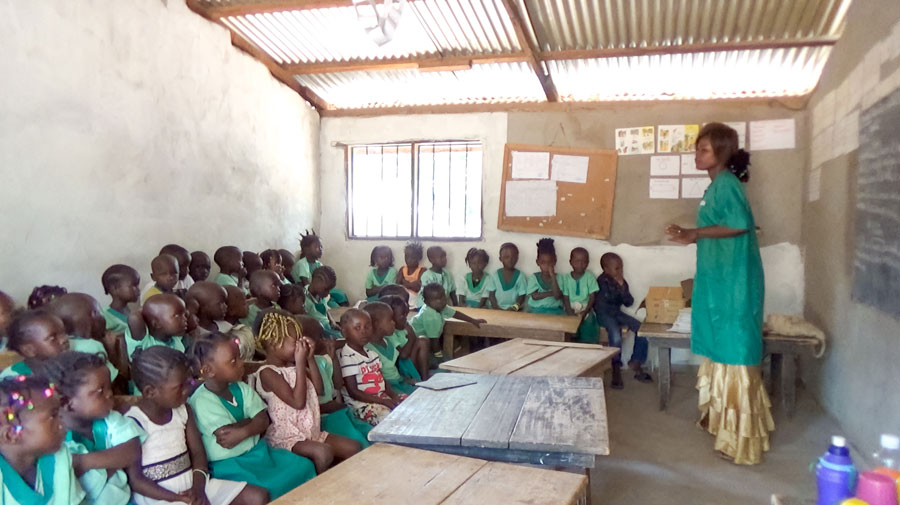 Photograph taken before the current health crisis. A class at a community school in Bangui, Central African Republic. A Baha'i principle underlying these schools is that local communities can be protagonists in providing education for their children.