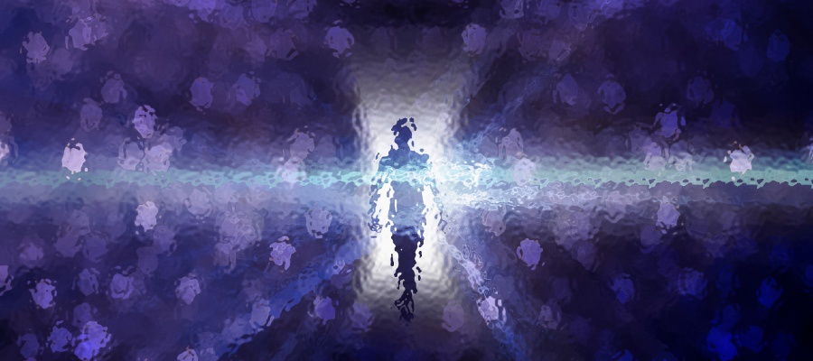 image of a silhouette walking into the light