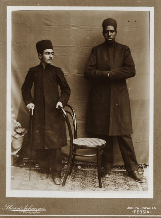 Wealthy Persian boy with African slave.