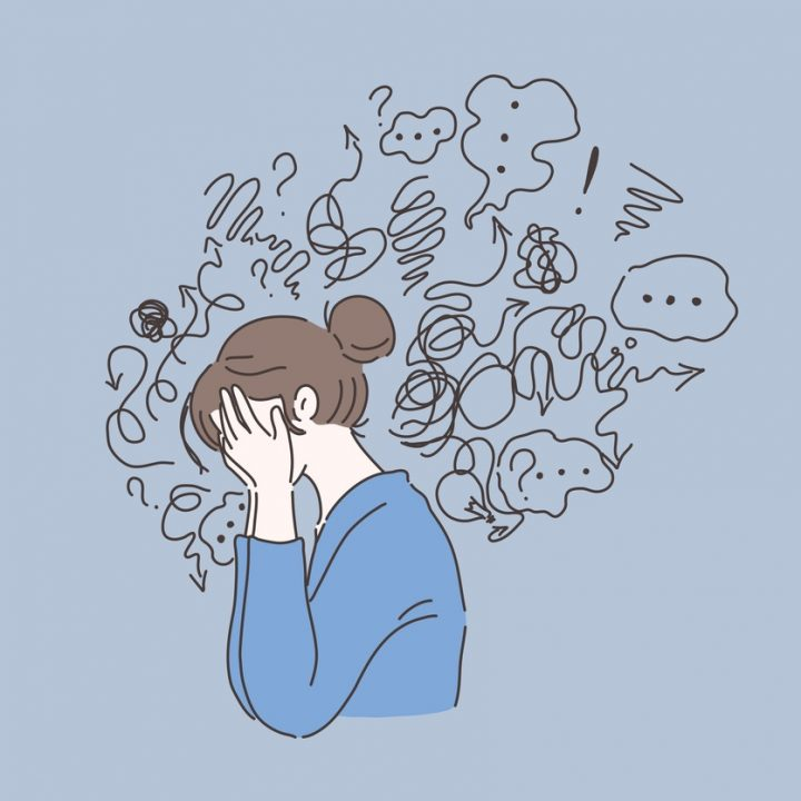 An illustration of a woman with anxious thoughts