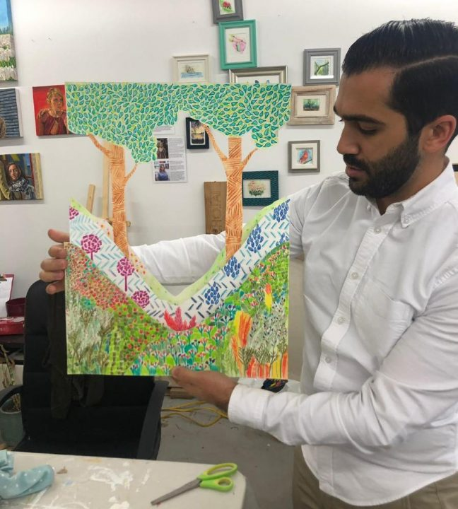 Saba Taghvai demonstrating the completed interior piece
